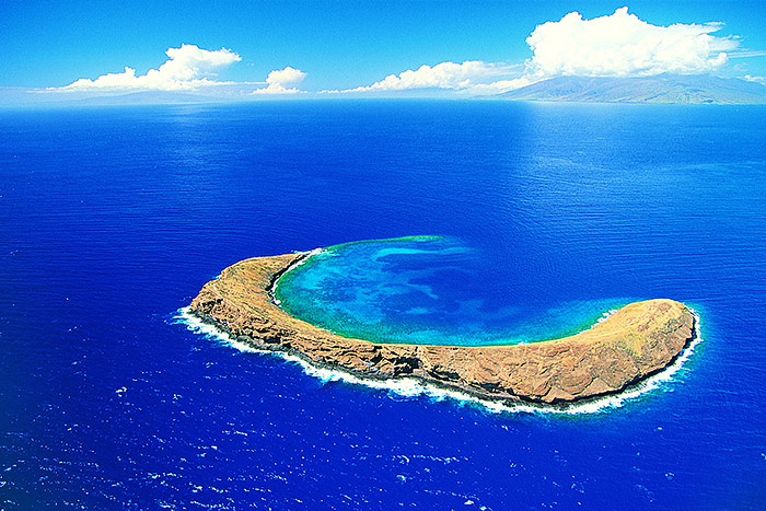 Molokini Crater in blue ocean